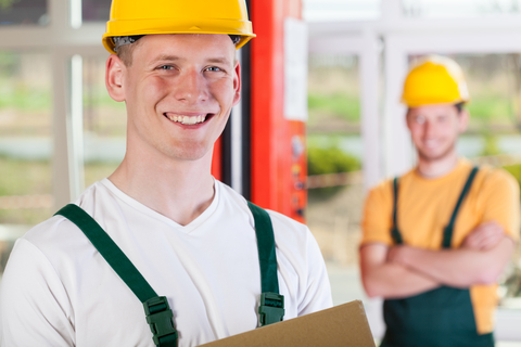 Smiling While Working in Factory